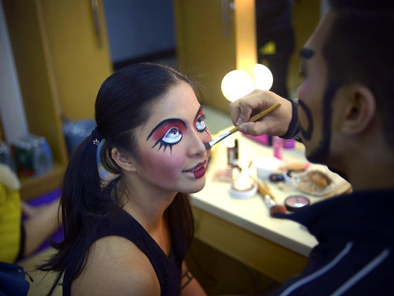Beijing: Dancers get ready backstage before the finals of the 2015 World Pole Dance Championship on April 12.