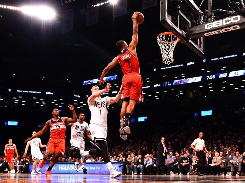 New York: Will Bynum (C) of the Washington Wizards scores against the Brooklyn Nets during their NBA game at the Barclays Center in Brooklyn, New York on April 10.