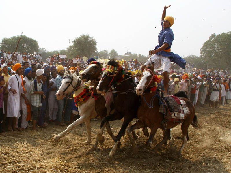 Nihangs displaying martial art on the concluding day of Baisakhi mela in Talwandi Sabo town of Bathinda. Kulbir Beera/HT