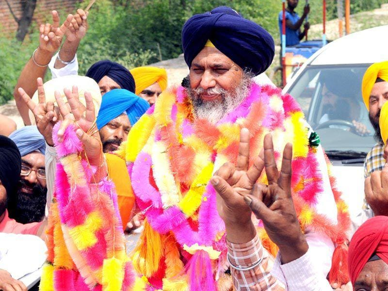 SAD candidate Gobind Singh Longowal with his supporters in a jubilant mood after their victory in by poll election at Dhuri in Sangrur district. Bharat Bhushan/HT