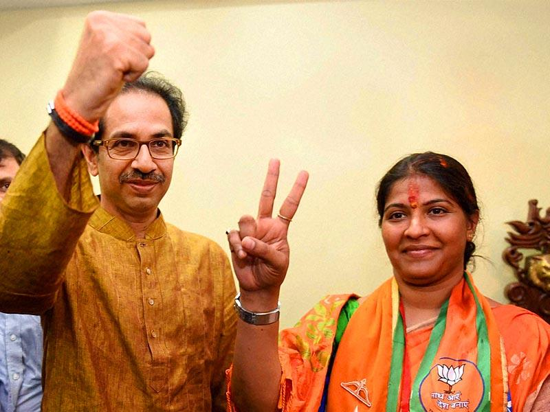 Shiv Sena chief Uddhav Thackeray poses for a photo with party candidate Trupti Sawant who won the Bandra (East) bypoll against Congress leader Narayan Rane, in Mumbai. (PTI photo)