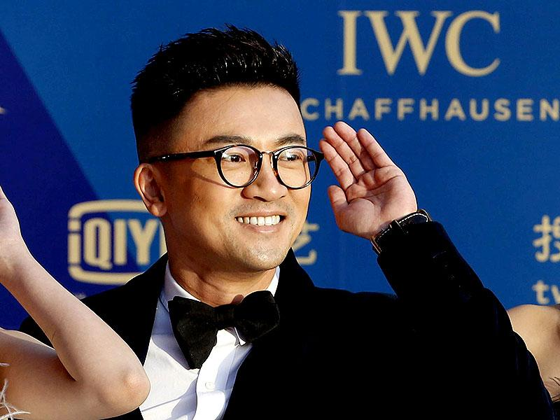 Taiwanese actor and singer Alec Su poses for pictures on the red carpet at the Beijing International Film Festival in Beijing, April 16, 2015. (Reuters)