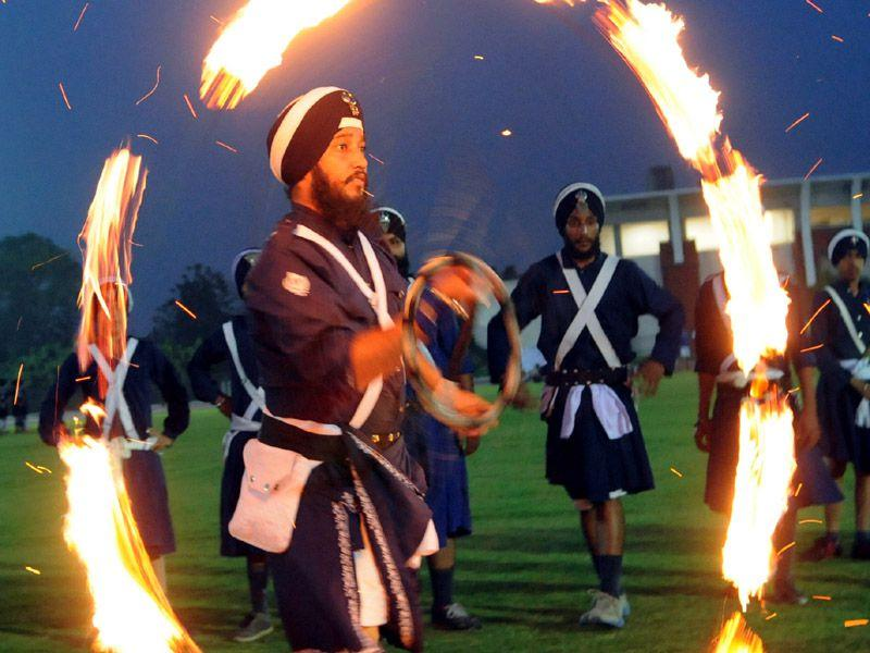 Gatka player performing fire stunt during the Sports Fest 'URJA 2015' of Thapar University in Patiala on Friday. Bharat Bhushan/HT