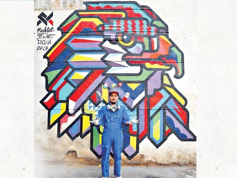 Rukkit, Thailand: Rukkit is a street artist from Thailand, who works as a graphic designer and is heavily inspired by magazine, music packaging, typography, and illustration. Bringing his style to Delhi walls, he created two pieces, one of an eagle - in Connaught Place, and the second of a crow - in Gole Market. Both pieces are bright, colourful and showcase the influence of the various styles that the artist draws his inspiration from.