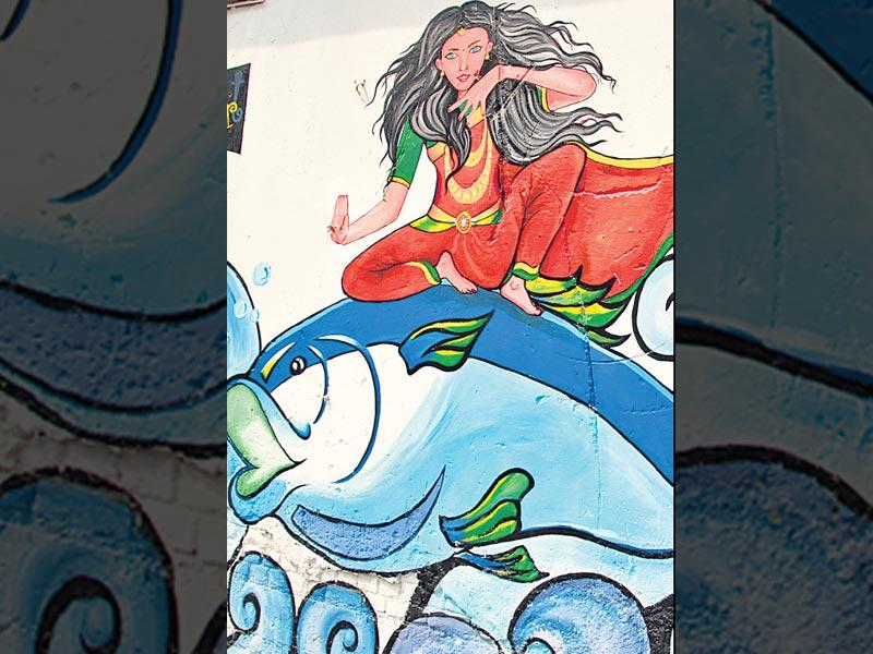 Delhi street art: Painted by a bunch of local artists, these walls speak of a common theme: women's empowerment. Each of the three walls in Connaught Place depicts a woman in a commanding and confident posture interacting with three basic elements - earth, wind and water.