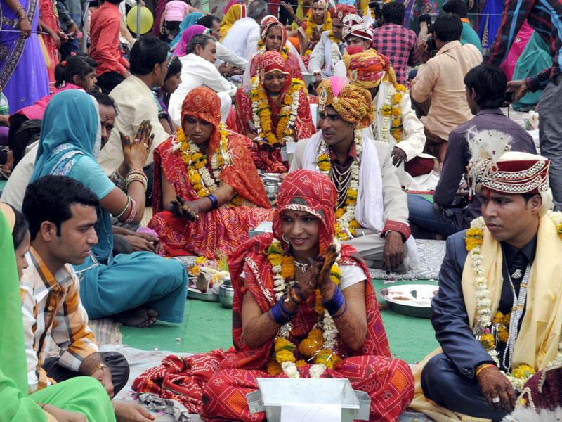 Mass marriage ceremonies of various communities took place in Indore on the occasion of Akshay Tritiya on Tuesday. (Shankar Mourya/HT photo)