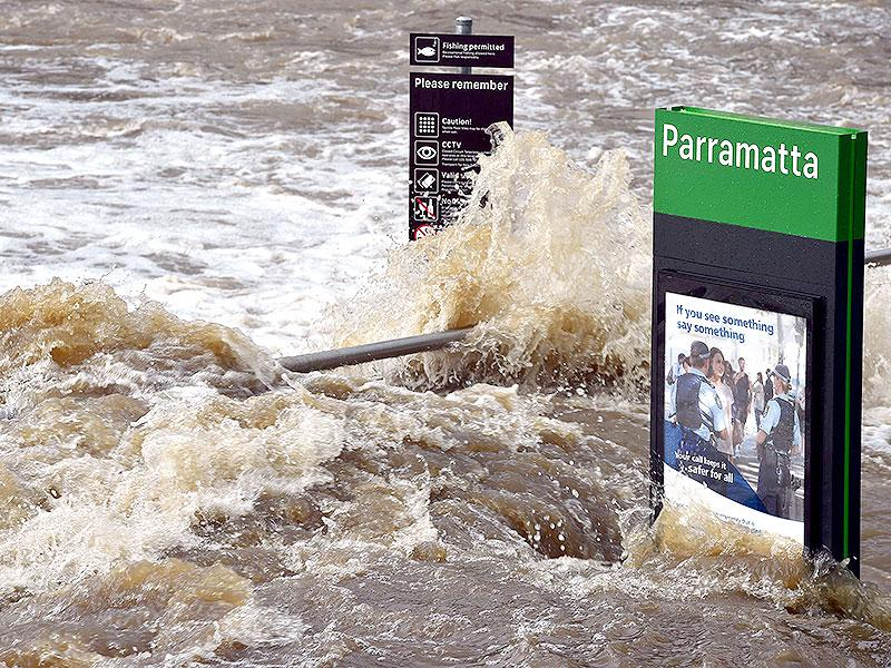 Flood waters enter the Parramatta ferry wharf in Sydney. A storm-tossed ship stuck outside Sydney Harbour with 2,500 passengers was finally able to dock on Wednesday. (AFP Photo)