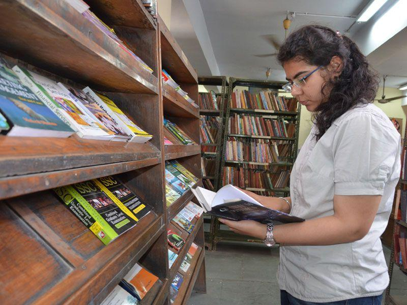 A girl going through books in Ambala central library. HT Photo