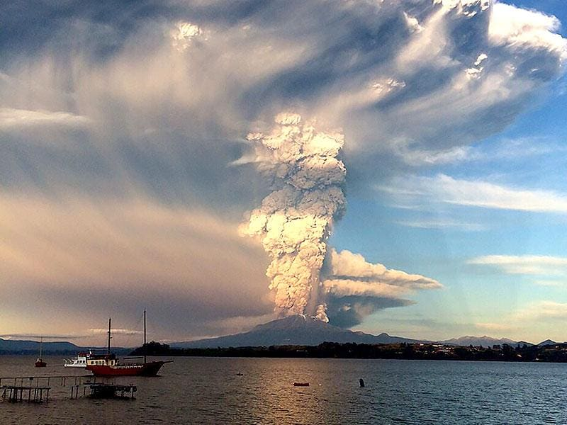View from Puerto Varas, southern Chile, of a high column of ash and lava spewing from the Calbuco volcano. AFP