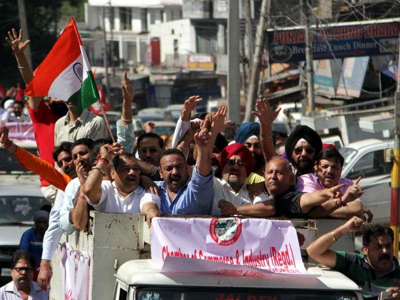 Members of Chamber of commerce raising slogans against state government decision to give AIIMS to Kashmir. Nitin Kanotra