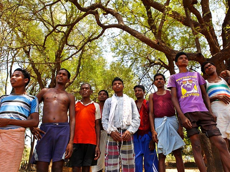 Men from Jangalpal village, Dantweada, who were accused of aiding Maoists in digging up a road. (Saumya Khandelwal/ HT Photo)