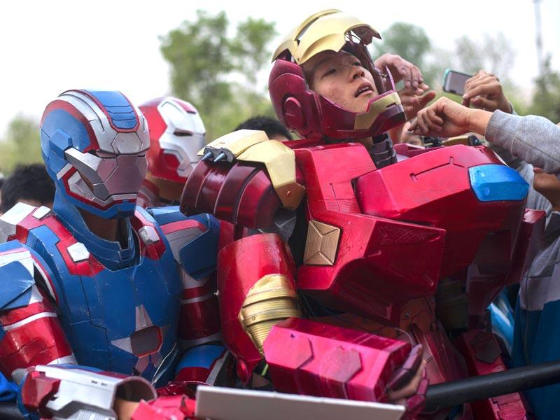 Beijing: Fans dressed like Iron Man wait for US actors during the promotion of Marvel's