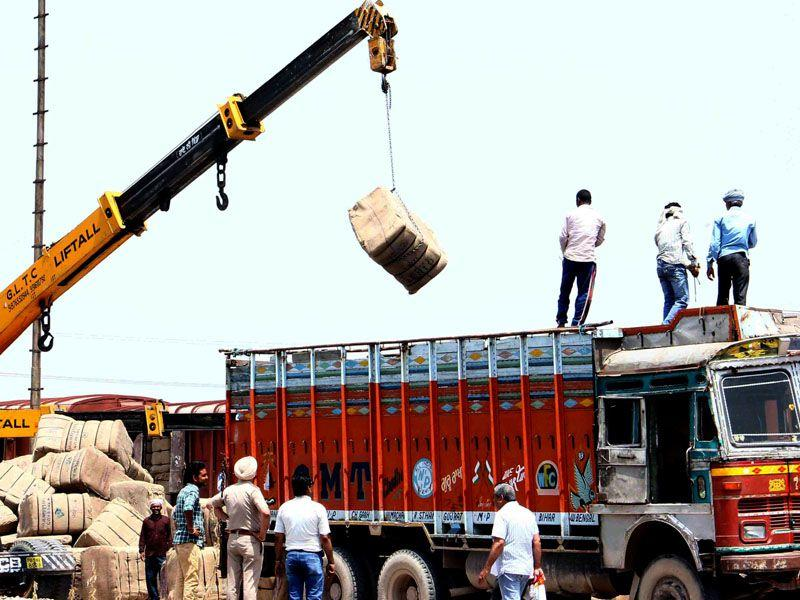 Labour refusing to unload truck of gunny bags, the authorities arranged crane to the service in Patiala. Bharat Bhushan/HT