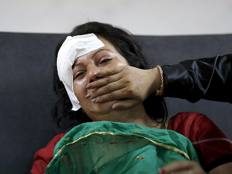 An injured woman cries after hearing news of a family member who died during an earthquake at a trauma center in Kathmandu. (Reuters)