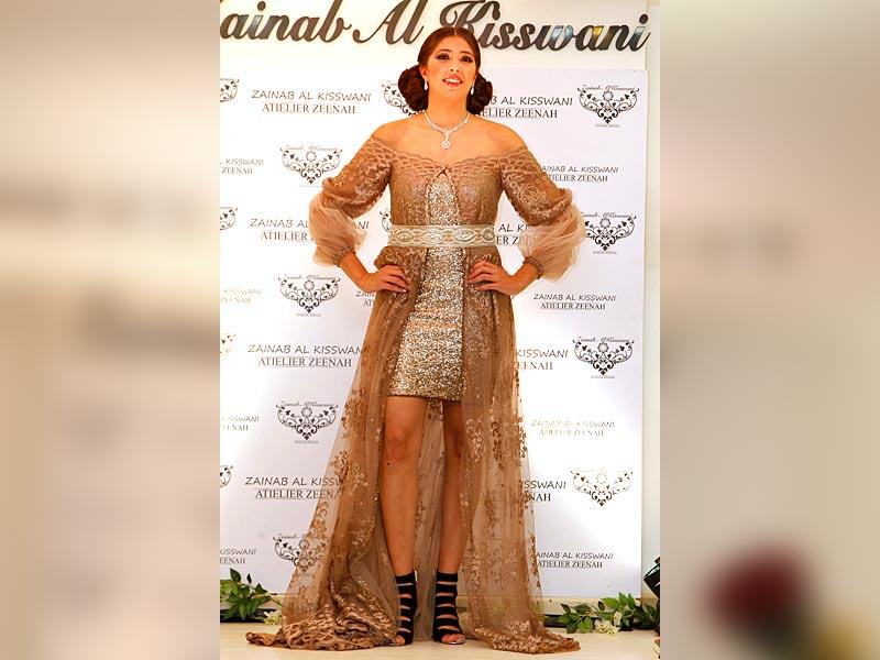 A model in a two-toned shimmery brown and beige number by Jordanian designer Zainab Al-Kiswani. (Reuters)