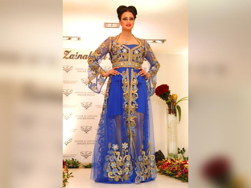 This cobalt blue gown with golden detailing by Zainab Al-Kiswani is the perfect example of Eastern-detailing-meets-Western-sensibilities. Agree?