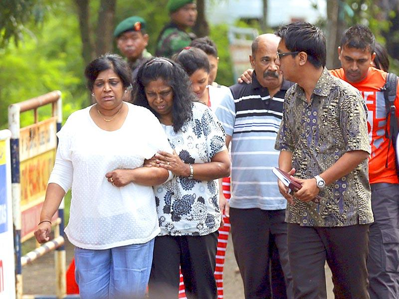 Family members of Myuran Sukumaran arrive at Wijayapura ferry port to cross to the prison island of Nusakambangan, in Cilacap, Central Java, Indonesia. (AP Photo)