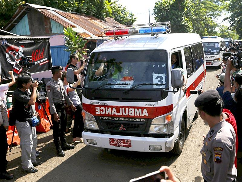 An ambulance bearing the name of Mary Jane Veloso, a Filipino facing execution, enters Wijayapura port as it heads to the prison island. (Reuters)