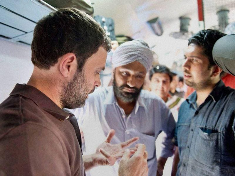 Rahul Gandhi hears grievances of farmers, including lifting of crops and crop damage on-board Sachkhand Express in Ambala. PTI photo