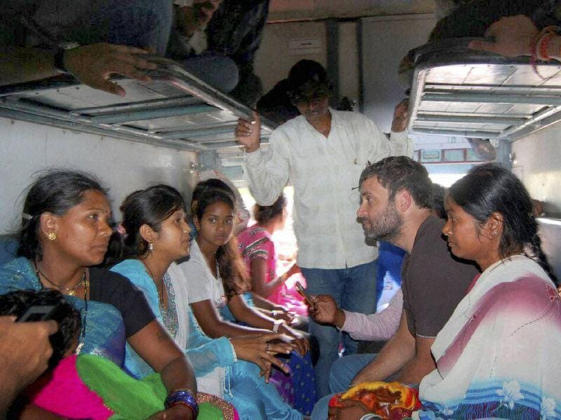 AICC vice-president Rahul Gandhi interacting s with passengers on-board Sachkhand Express in Ambala. PTI photo