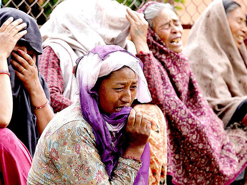 A group of women break into tears as they watch their relatives being cremated at the Hanuman Ghat in Kathmandu. (Raj K Raj/HT Photo)