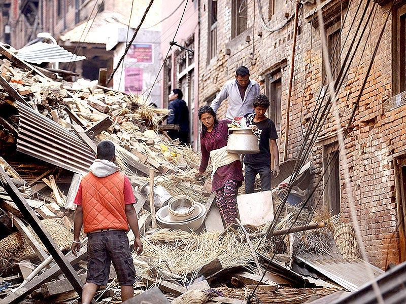 People walk through a damaged site two days after the earthquake, in Kathmandu. (Raj K Raj/HT Photo)