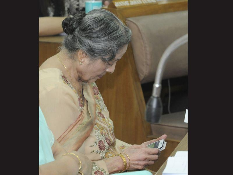 Here in this picture is Amrita Tiwari (nominated), who, too, is busy with her phone. Gurpreet Singh/HT