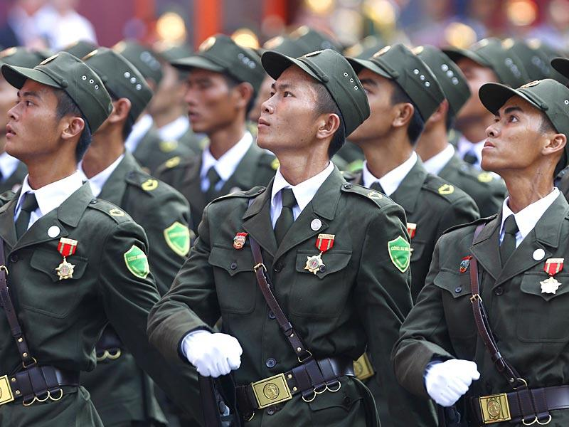 Village policemen march during a military parade. (Reuters)