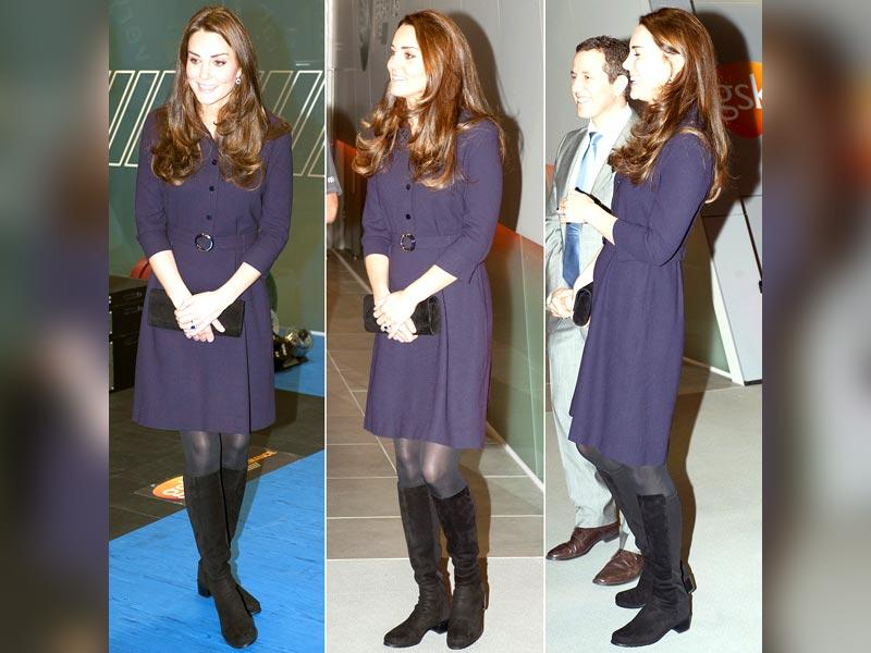 Let's revisit this, before there's a sibling on the scene: Kate revealed her tiny baby bump in a purple Goat dress in London in November, 2015.