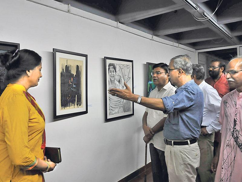 Visitors have a look at the paintings at Bharat Bhawan during Raja Ravi Varma memorial group exhibition, in Bhopal on Wednesday. (Mujeeb Faruqui/HT photo)