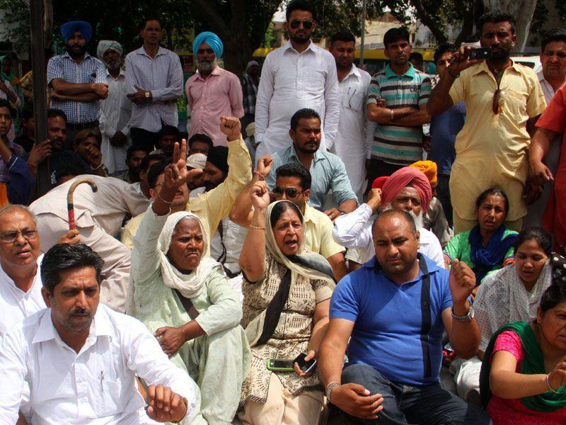 Residents staging a protest against the state government outside the Moga civil hospital on Thursday. JS Grewal/HT