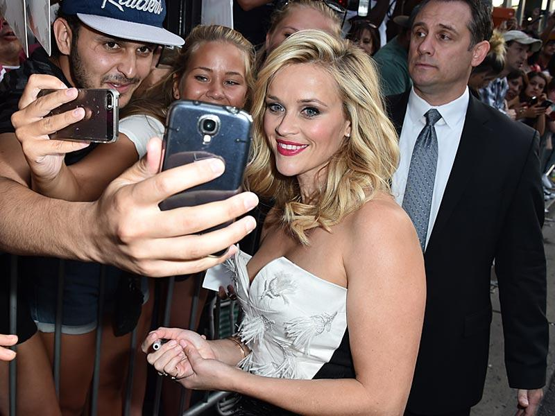 Reese Witherspoon takes a photo with a fan at the premiere of Hot Pursuit at the TCL Chinese Theatre on Thursday, April 30, 2015, in Los Angeles. (Photo: AP)