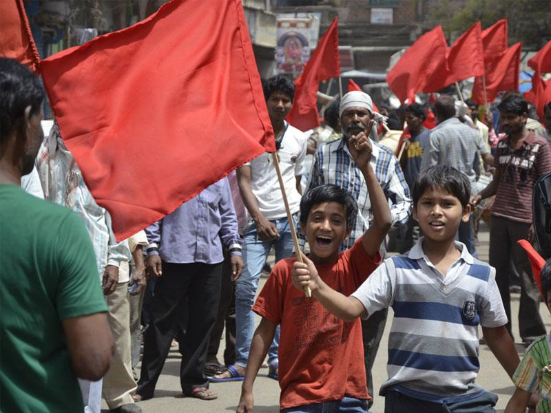 Workers and their children march in May Day rally, in Bhopal on Friday. (Mujeeb Faruqui/HT photo)
