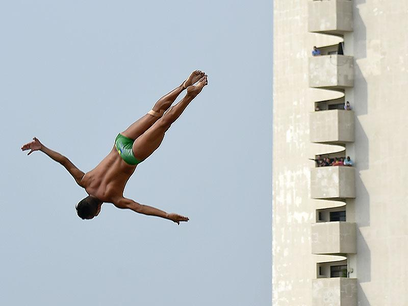 Cartagena: Brazilian Jucelino Junior jumps from the 27-meter-high platform during the Red Bull Cliff Diving World Series 2015 in Cartagena, Bolivar department Colombia, on April 25, 2015.