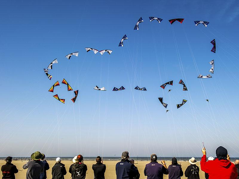Berck, France: People fly their kites to form the shape of a car in the sky on the beach in Berck, northern France, on April 20, 2015, during the 29th