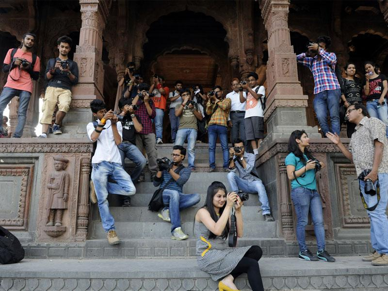 Students participate in heritage photo walk at Krishnapura Chhatri, Rajwada, in Indore on Saturday. (Arun Mondhe/HT photo)