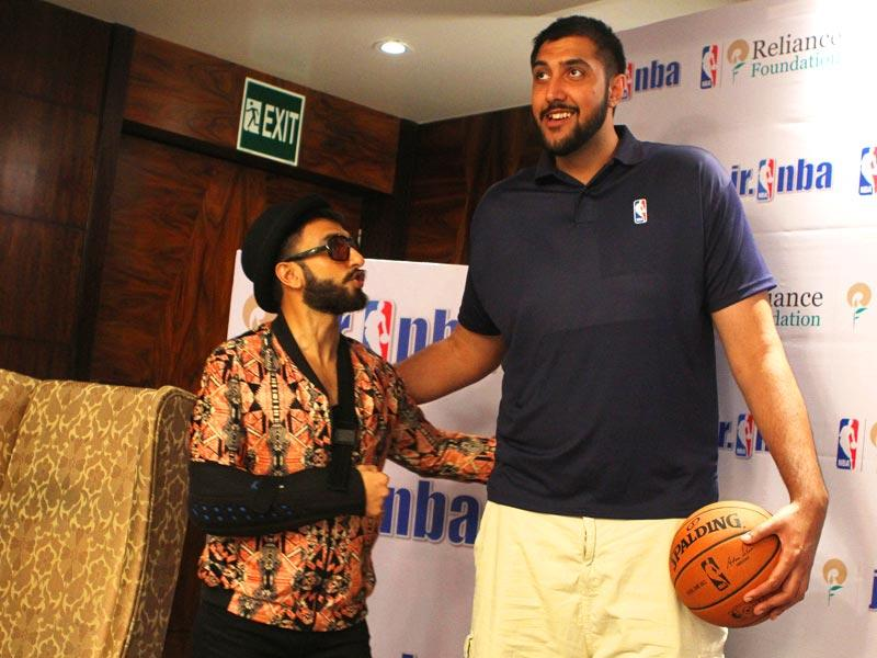 Ranveer Singh with 7.5ft tall NBA's first Indian origin Basketball player Sim Bhullar at a Mumbai hotel on Saturday, May 2, 2015. (Photo by Arijit Sen/ Hindustan Times)