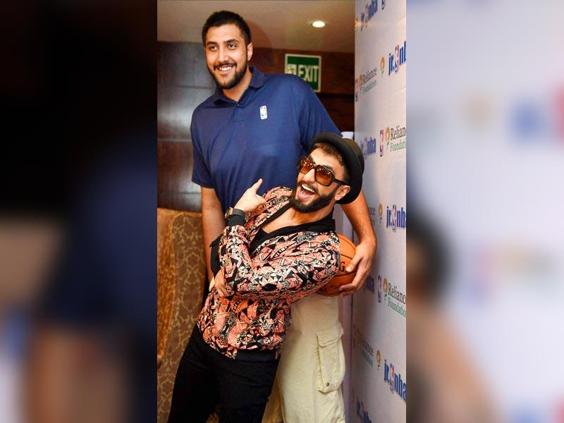 NBA's Indian-origin basketball player Sim Bhullar poses with Ranveer Singh during a press conference in Mumbai on Saturday. (PTI Photo)