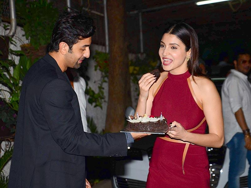 Looks like she just tasted that cake in her hand! Anushka Sharma and Ranbir Kapoor at the special screening of Bombay Velvet on Anushka Sharma`s birthday in Mumbai on 1st May, 2015. Bombay Velvet is all set to hit theatres on May 15. (Photo: IANS)