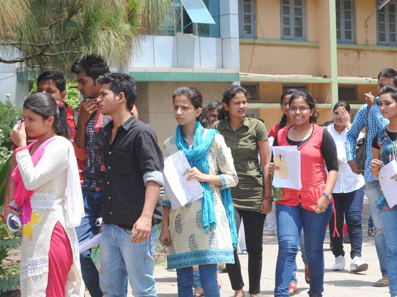 Students come out of the examination centre after completion of All India Pre-medical Test, in Bhopal on Sunday. (HT photo)