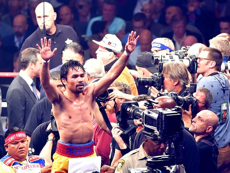 Manny Pacquiao gestures to the crowd after losing to Floyd Mayweather Jr. by unanimous decision in their welterweight unification championship bout. (Getty Images/AFP)