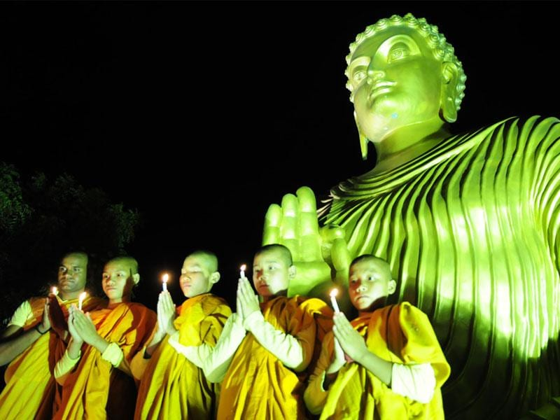 Buddha monks offer prayer on the eve of Buddha Purnima at a monastery, in Bhopal on Sunday. (Mujeeb Faruqui/HT photo)
