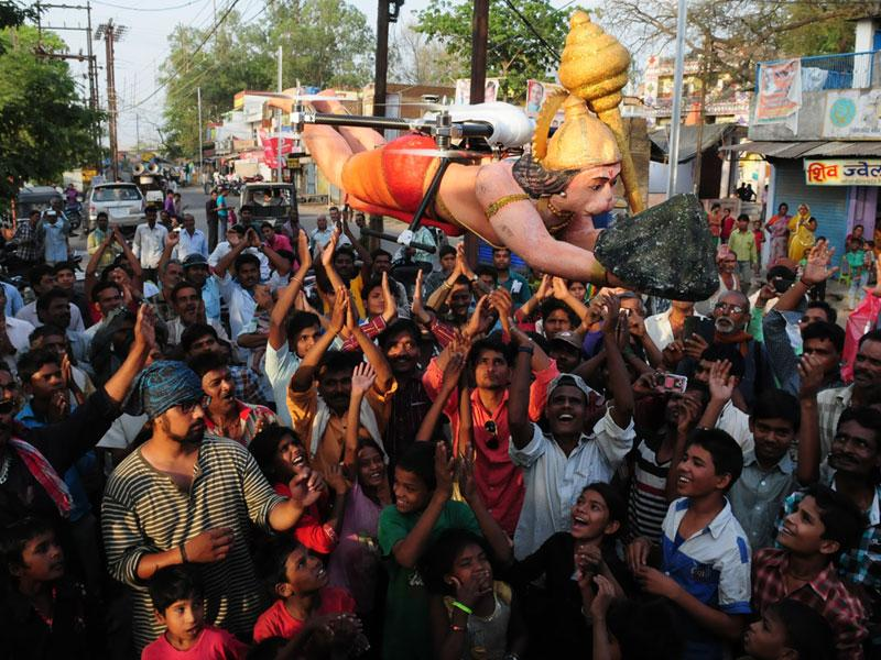 Lord Hanuman's drone flying over the devotees during a promotional event of an upcoming serial, in Bhopal on Sunday. (Mujeeb Faruqui/HT photo)