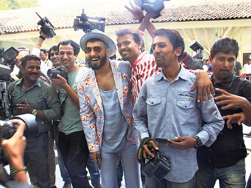 Ranveer Singh poses with fans at a promotional event for Dil Dhadakne Do.