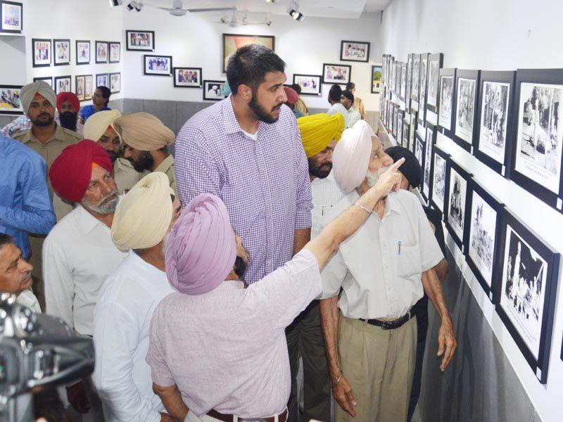 Sim Bhullar taking a look at the painting of Bhagat Puran Singh during his visit at Pingalwala in Amritsar on Tuesday. Sameer Sehgal/HT