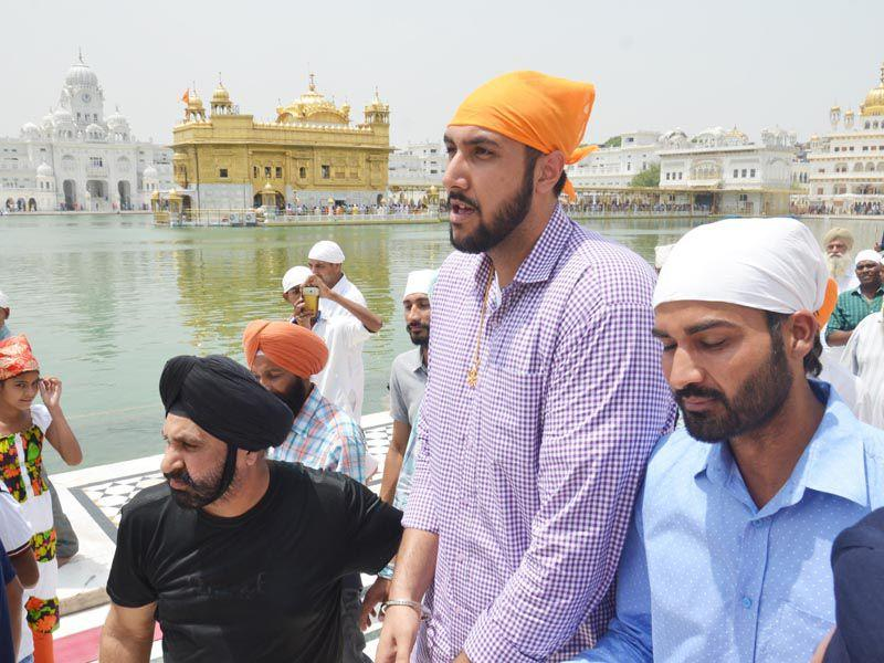 Sim Bhullar paying obeisance at the Golden Temple in Amritsar on Tuesday. Sameer Sehgal/HT