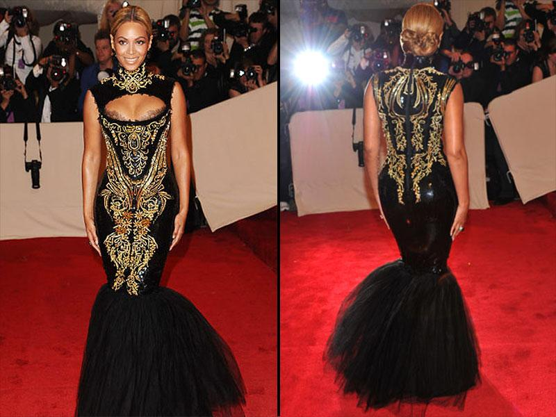 Beyonce, 2011; Queen B referenced 'Dolce Vita' style in this black and gold fishtail Emilio Pucci brocaded dress with lace décolletage detailing.