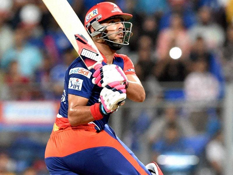 Delhi Daredevils (DD) batsman Yuvraj Singh plays a shot against Mumbai Indians (MI) during the IPL 2015 match between the two sides at Wankhede Stadium, Mumbai. (PTI Photo)