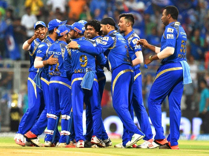 Mumbai Indians players (MI) celebrate the wicket of a Delhi Daredevils (DD) batsman during their IPL 2015 match at Wankhede Stadium in Mumbai. (PTI Photo)