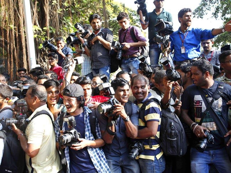 Members of the media jostle for space outside the Mumbai Sessions court during Bollywood actor Salman Khan's verdict in Mumbai. (AP Photo)